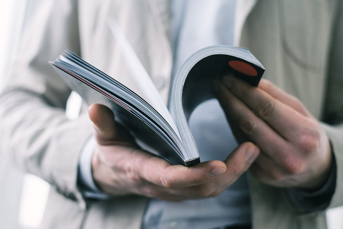 Close up of hands flipping through a book